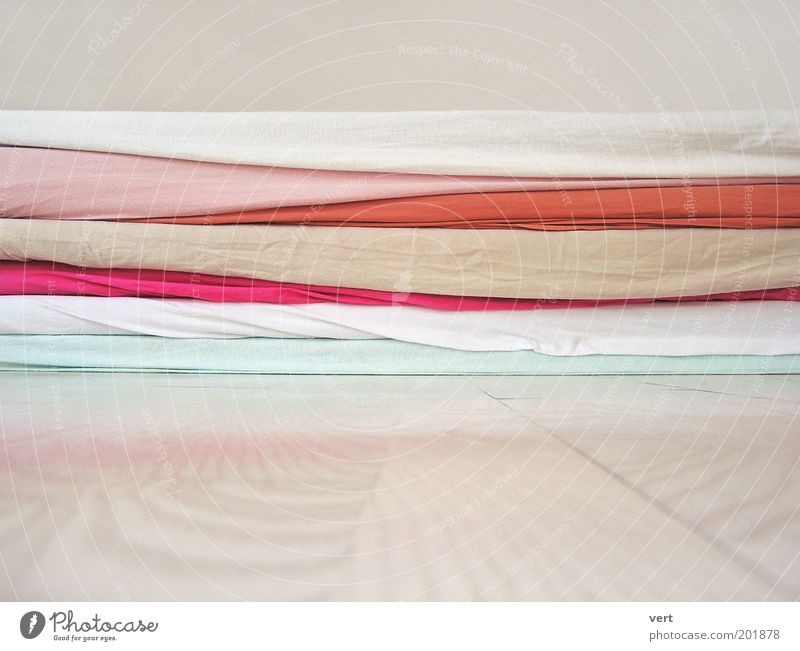 White Calm Relaxation Pink Soft Lie Cloth Turquoise Stack Comfortable Sheet Wooden floor Attentive Pastel tone Structures and shapes Floor covering