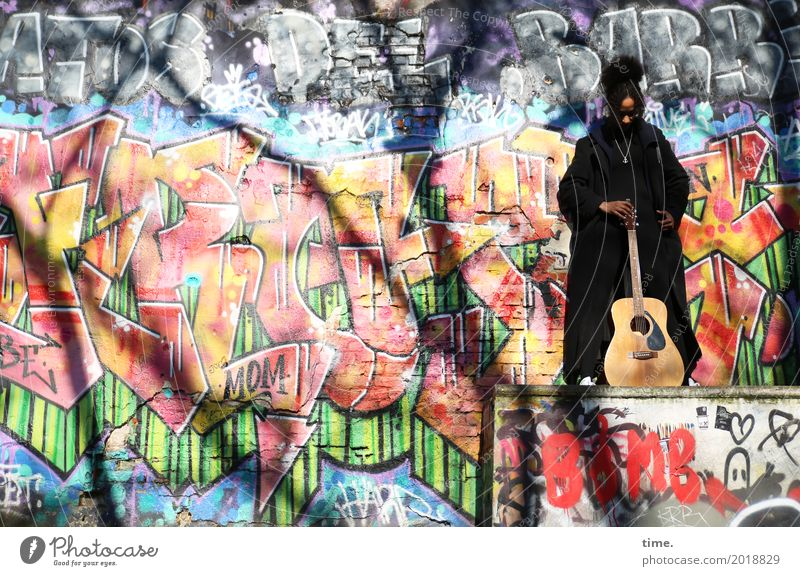 Music | Ghetto Priestress Feminine Woman Adults 1 Human being Artist Musician Guitar Wall (barrier) Wall (building) Coat Hair and hairstyles Black-haired Curl