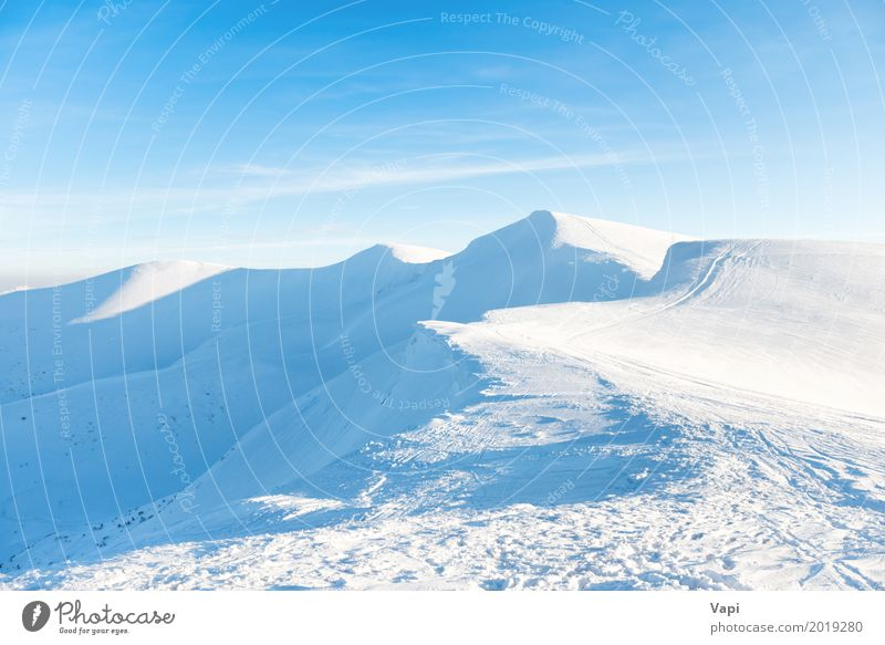 Beautiful winter landscape with snow mountains Sky Nature Vacation & Travel Blue Beautiful White Sun Landscape Clouds Far-off places Winter Mountain Snow Sports Tourism Rock