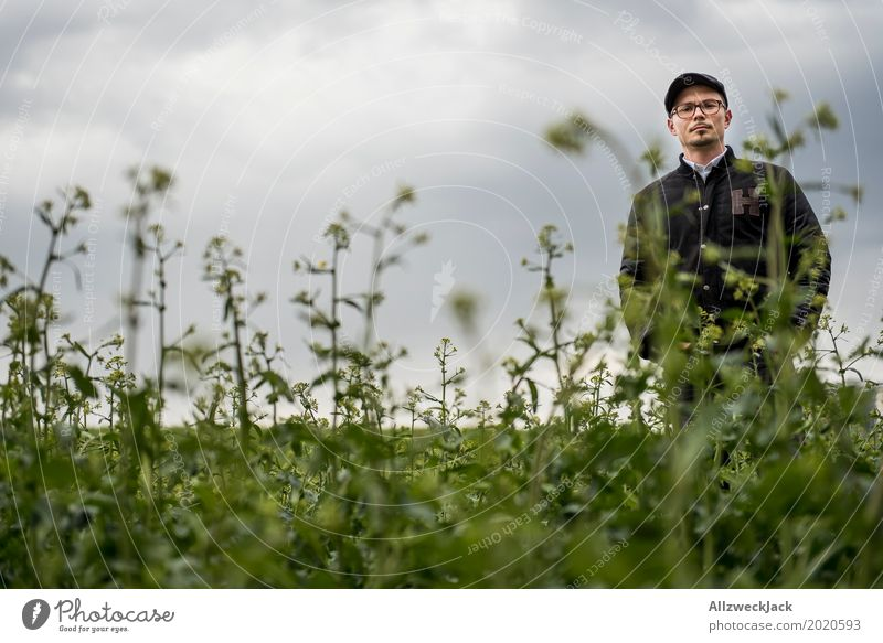 Cloudy and man in the weeds 1 Clouds Gray clouds Bad weather Field Green Weed Plant Man Young man Doomed Stand Wait Forest-dweller Lost Wacky Farmer Agriculture