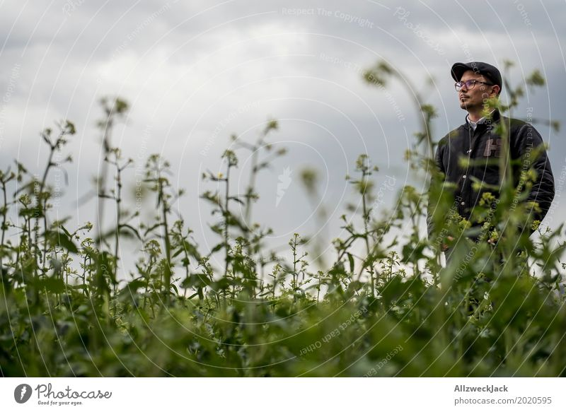 Cloudy and man in the weeds 2 Clouds Gray clouds Bad weather Field Green Weed Plant Man Young man Doomed Stand Wait Forest-dweller Lost Wacky Farmer Agriculture