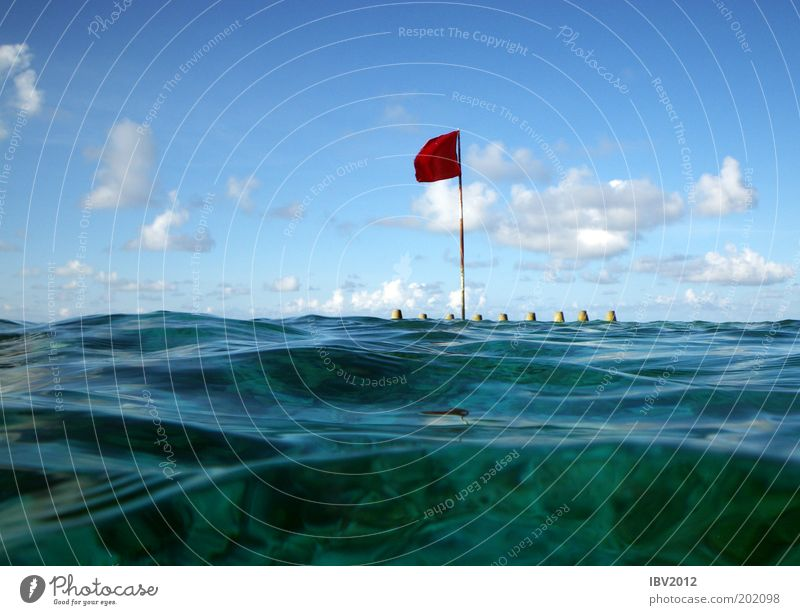 Red flag in paradise II Leisure and hobbies Vacation & Travel Tourism Trip Far-off places Freedom Ocean Aquatics Nature Landscape Water Sky Clouds Sun Sunlight