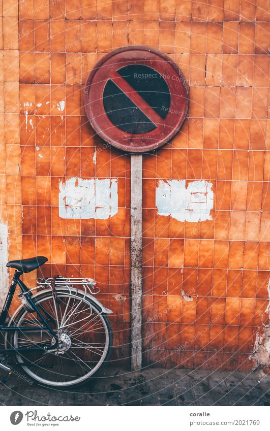 stopping restriction Small Town Capital city Outskirts Old town Wall (barrier) Wall (building) Facade Signs and labeling Bicycle City life Morocco Orange
