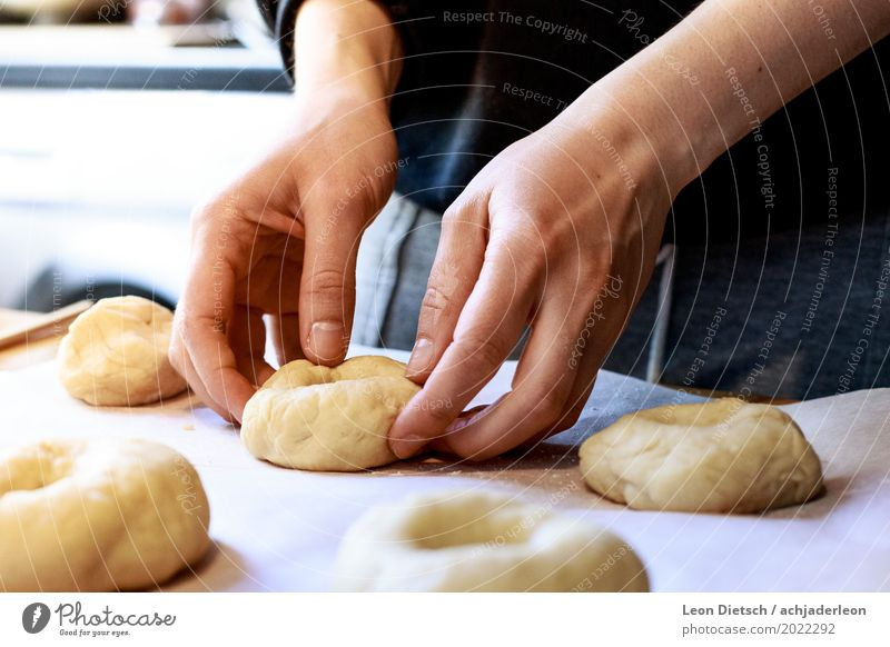 And now with a lot of feeling. Food Dough Baked goods Bagel Authentic Soft Brown Yellow Orange Black White Baking Hand shape Cooking Colour photo Subdued colour