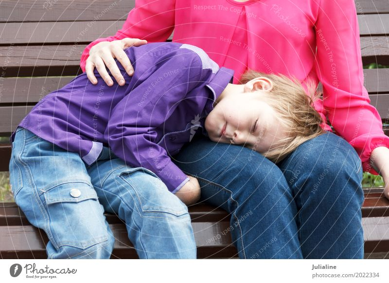Mother with sleeping son has a rest Leisure and hobbies Child Schoolchild Boy (child) Woman Adults Man 2 Human being 3 - 8 years Infancy 8 - 13 years