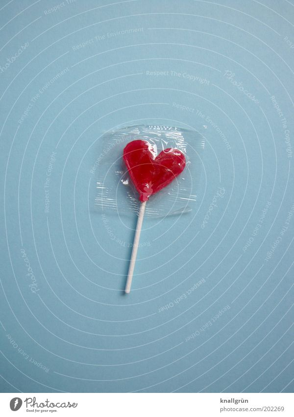 Fuck you! Food Candy Lollipop Nutrition Heart Delicious Sweet Blue Red White Joy Appetite To enjoy Happy Packaged Colour photo Close-up Deserted Copy Space left
