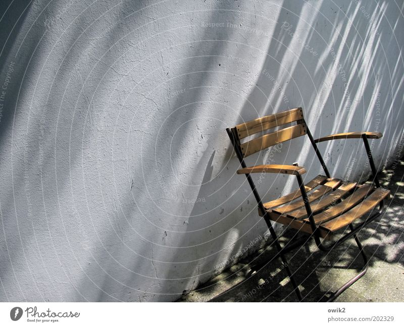Calm Wall (building) Freedom Wood Warmth Garden Wall (barrier) Stone Metal Weather Contentment Wait Concrete Climate Living or residing Chair