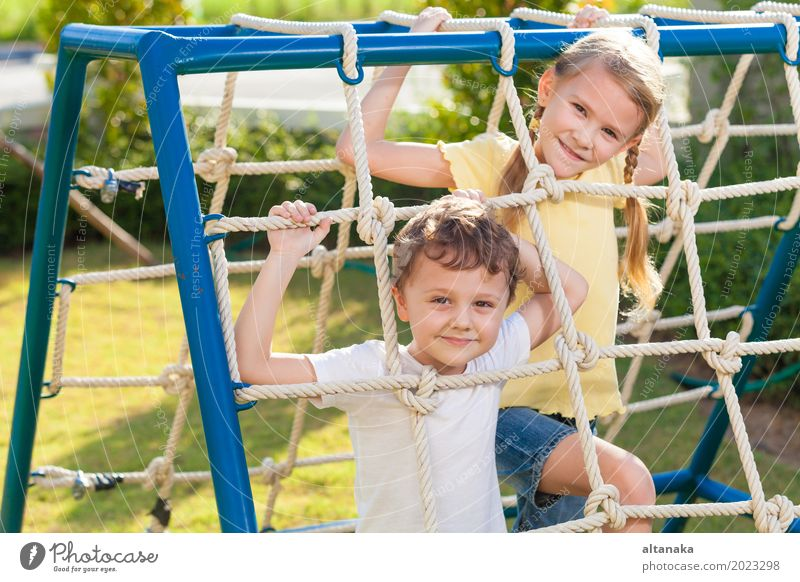 happy brother and sister playing on the playground Human being Child Vacation & Travel Summer Relaxation Joy Face Lifestyle Emotions Sports Boy (child) Laughter