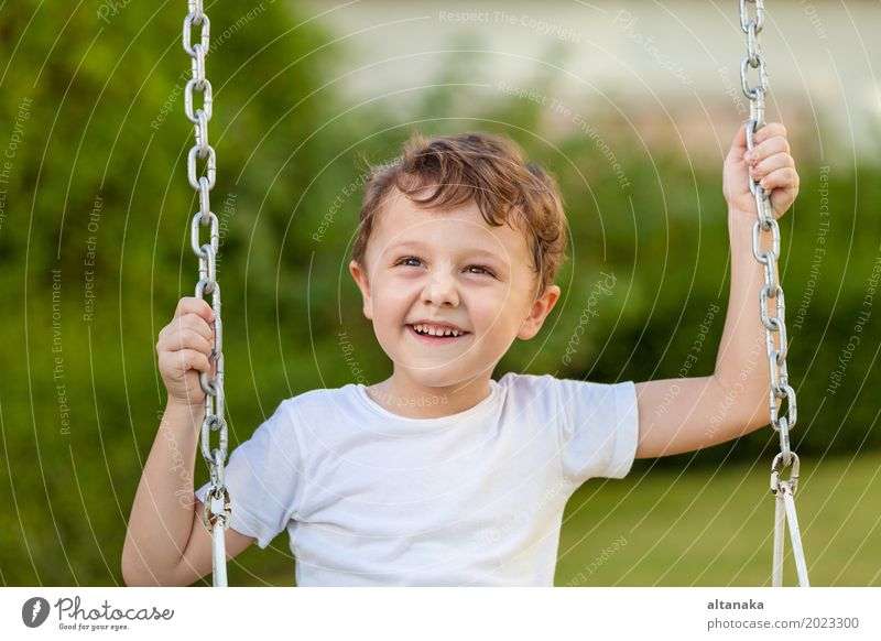 happy little boy playing on playing on the playground Lifestyle Joy Happy Face Relaxation Leisure and hobbies Playing Vacation & Travel Adventure Summer