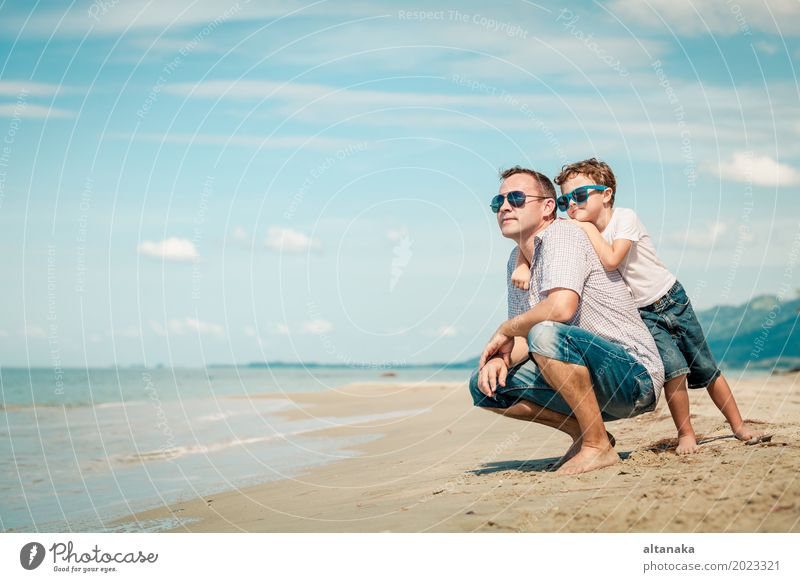 Father and son playing on the beach at the day time Lifestyle Joy Relaxation Leisure and hobbies Playing Vacation & Travel Trip Freedom Summer Sun Beach Ocean
