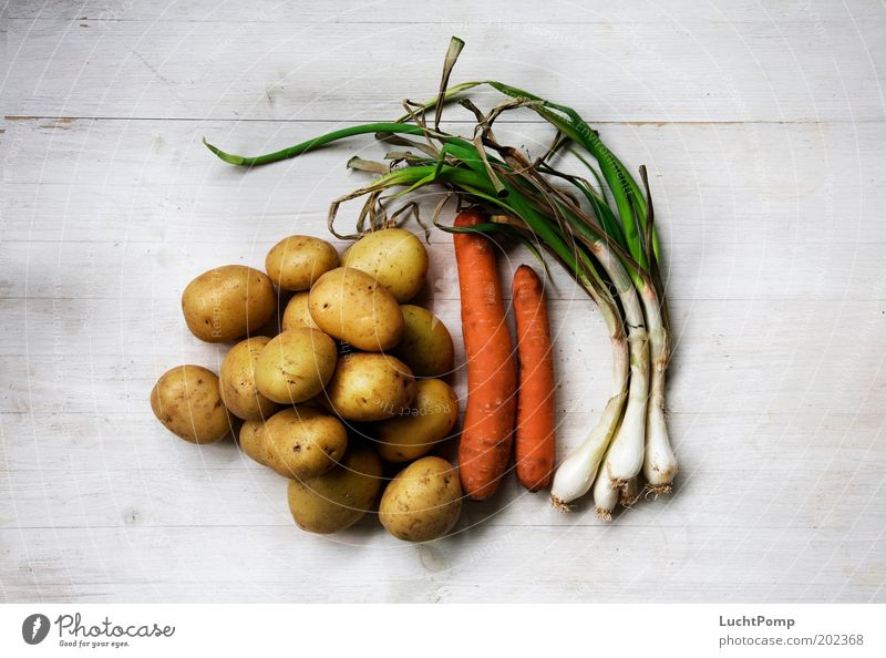 """There's still soup to be made!"" Vegetables for soup Potatoes Carrot Bulb Wooden table White Old Stew Ingredients Leek Early onion Wrinkles Shriveled Nutrition"