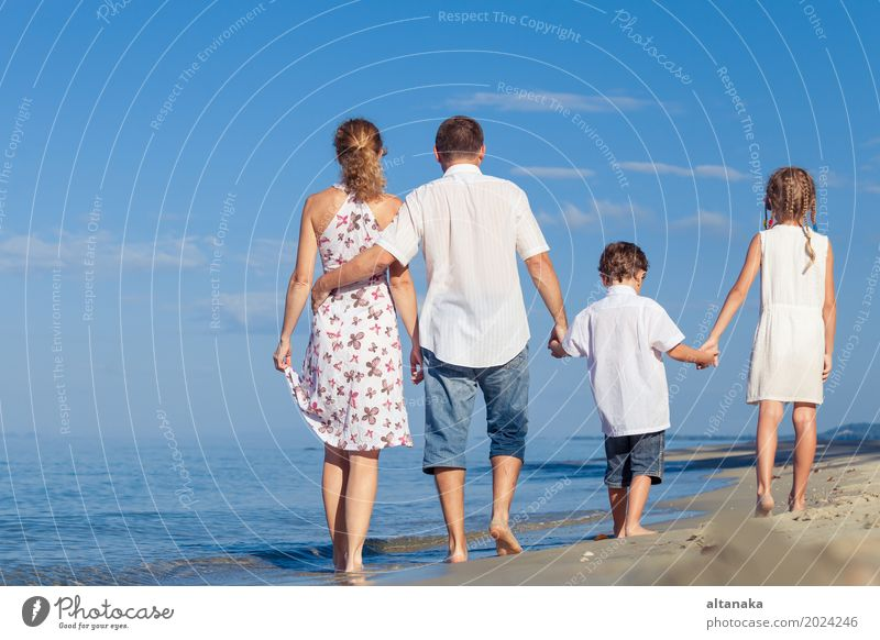 Happy family walking on the beach at the day time. Woman Child Nature Vacation & Travel Summer Sun Ocean Relaxation Joy Beach Adults Life Lifestyle Love Sports