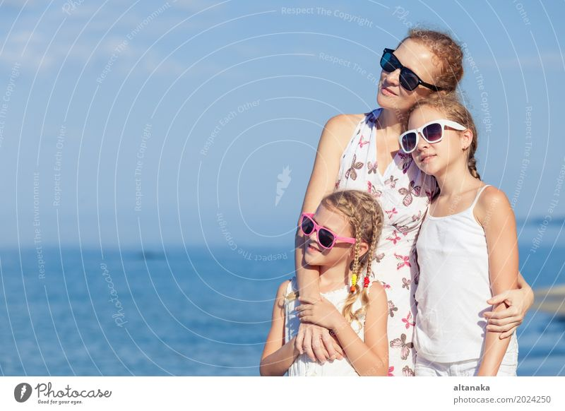 Mother and children playing on the beach at the day time. Lifestyle Joy Relaxation Leisure and hobbies Playing Vacation & Travel Trip Adventure Freedom Summer