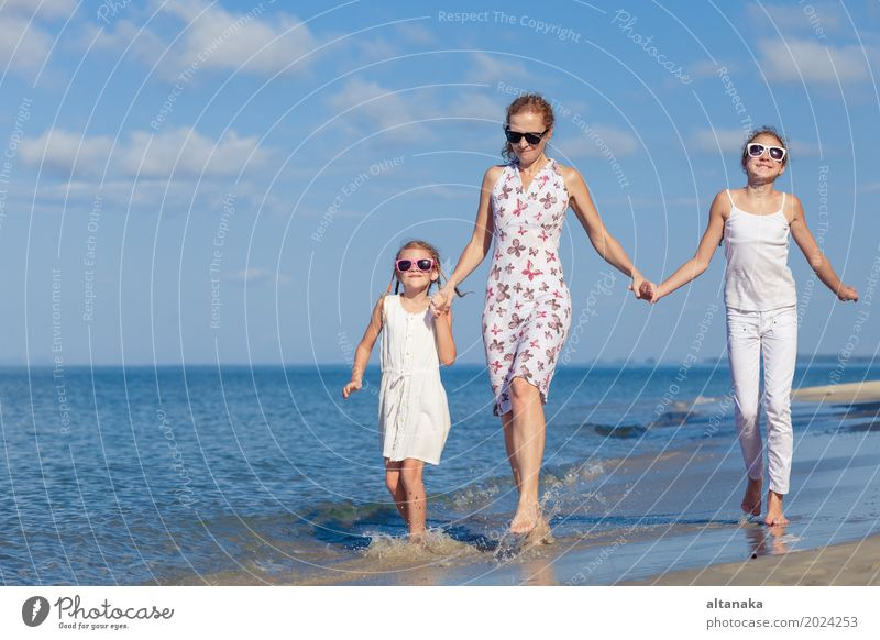 Mother and children playing on the beach at the day time. Child Nature Vacation & Travel Summer Sun Hand Ocean Relaxation Joy Beach Adults Life Lifestyle Love