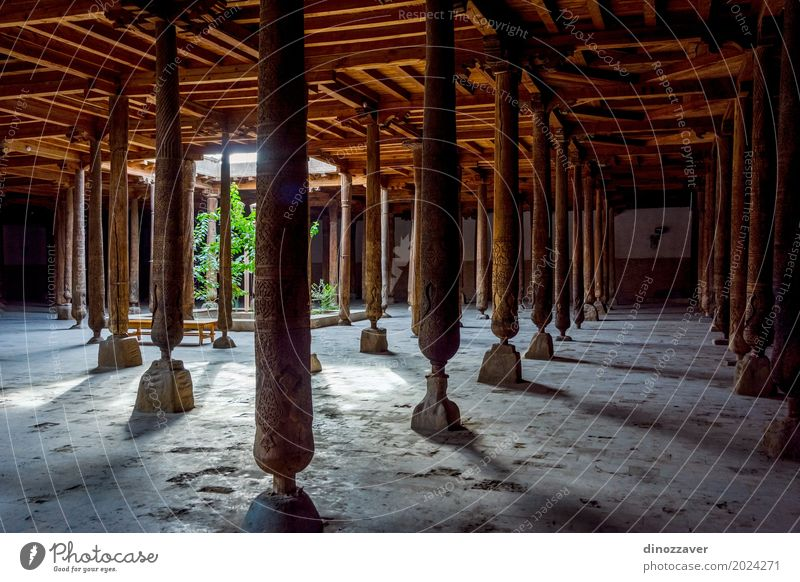 Carved wooden pillars in madrassa, Khiva Design Tourism Sun Decoration Art Culture Church Building Architecture Wood Ornament Old Historic Religion and faith