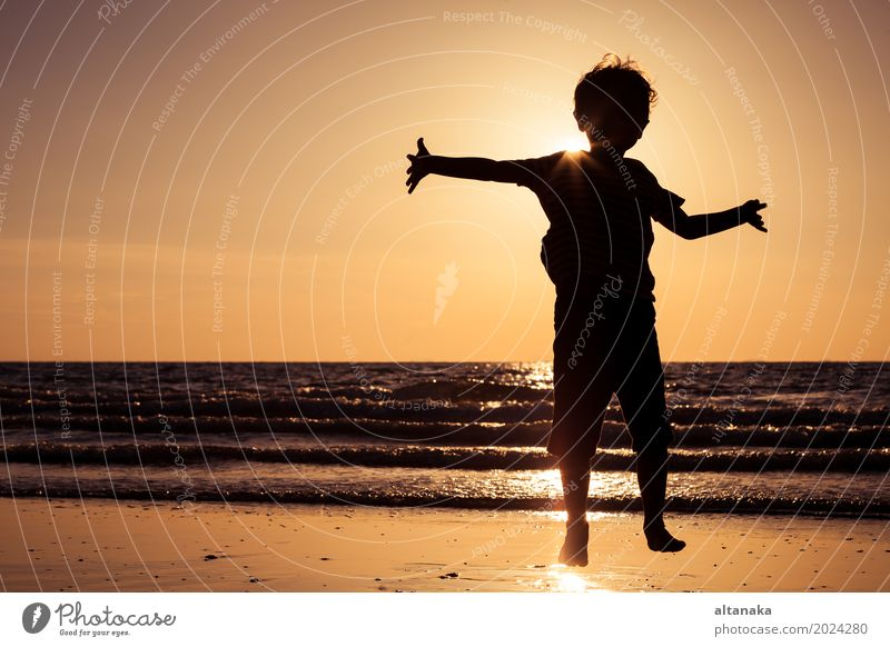 Happy little boy running on the beach Child Nature Vacation & Travel Man Summer Sun Hand Ocean Joy Beach Adults Lifestyle Love Sports Boy (child)