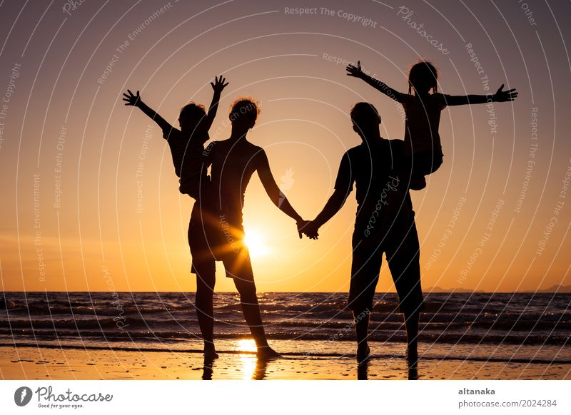 Silhouette of happy family Lifestyle Joy Leisure and hobbies Playing Vacation & Travel Trip Freedom Summer Sun Beach Ocean Child Boy (child) Woman Adults Mother
