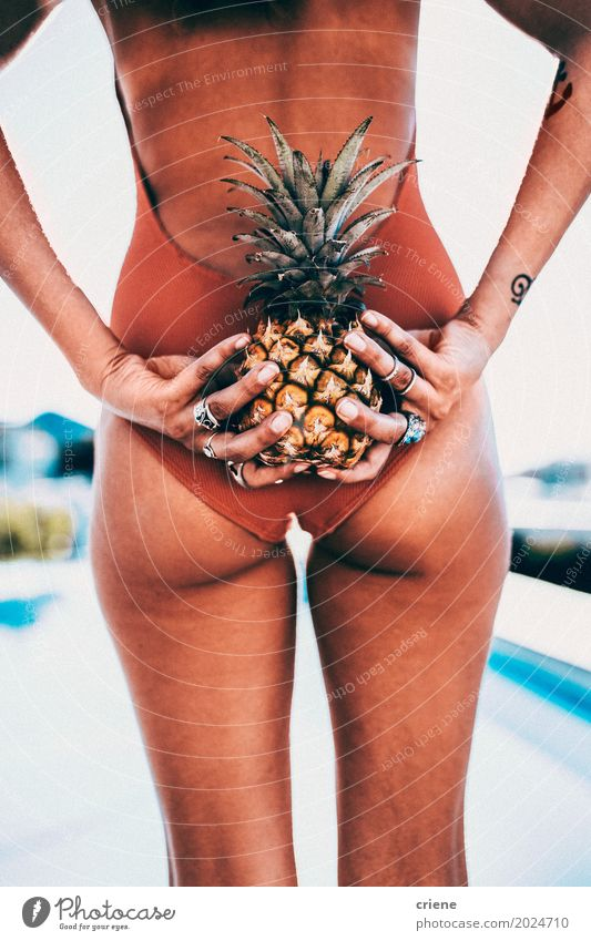 Attractive female adult holding pineapple behind her back Woman Vacation & Travel Youth (Young adults) Young woman Summer Sun Eroticism Joy 18 - 30 years Adults