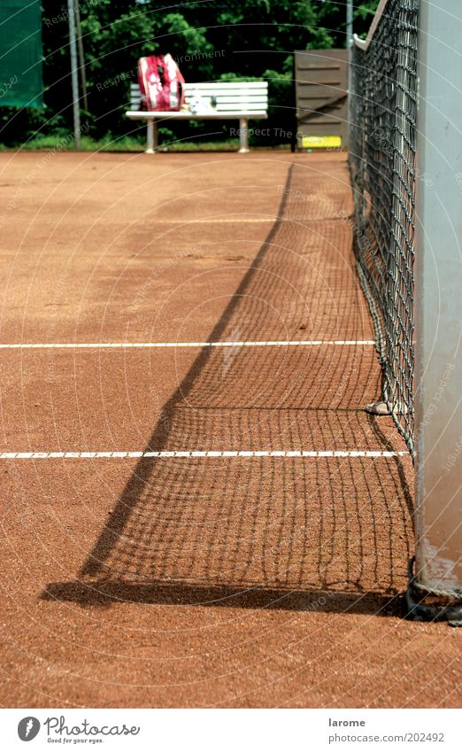 rest Leisure and hobbies Summer Tennis Sand Red Break Colour photo Exterior shot Deserted Copy Space left Day Deep depth of field Tennis court Net Bench Shadow