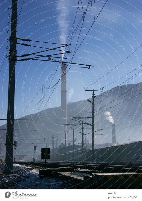 Sky Blue Fog Environment Electricity Technology Industrial Photography Alps Railroad tracks Train station Exhaust gas Share Valley Emission Electrical equipment