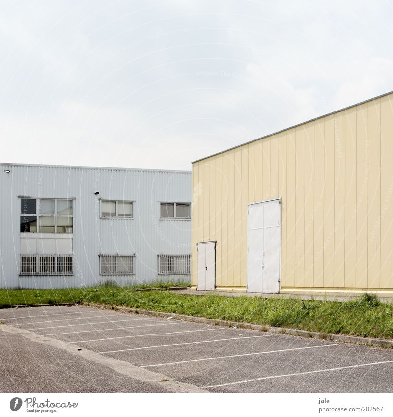 parking space Factory Industry Trade Company Sky Industrial plant Places Manmade structures Building Parking lot Facade Window Door Industrial zone Colour photo