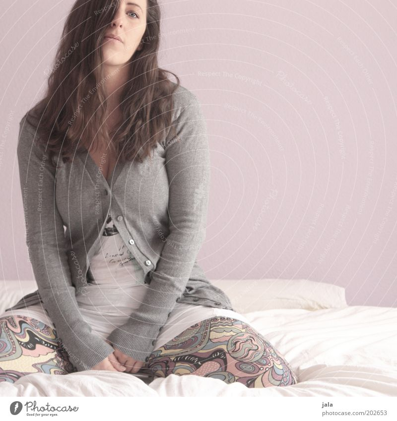 So what? Human being Feminine Woman Adults 1 Clothing Brunette Sit Boredom Colour photo Interior shot Copy Space right Day Forward Young woman Bed Gray Cardigan