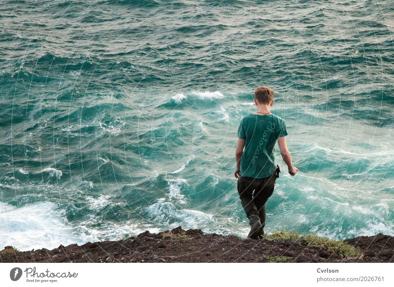 One with the sea Ocean Waves Masculine Young man Youth (Young adults) 1 Human being 18 - 30 years Adults Water Rock Lakeside T-shirt Blonde Short-haired Going