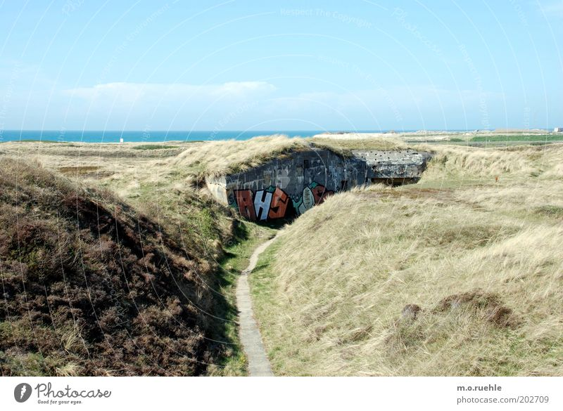 bunkers Vacation & Travel Trip Sightseeing Beach Landscape Sand Air Sky Beautiful weather Hill Coast Dune Marram grass Horizon Graffiti Dugout Jutland Concrete