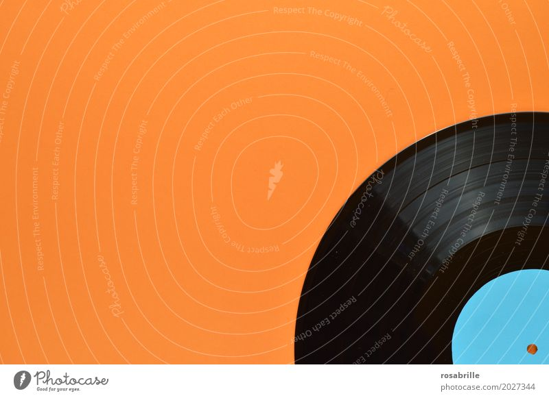 my old records - part of an old black vinyl record on orange background with blank turquoise label Entertainment Party Music Disc jockey Feasts & Celebrations