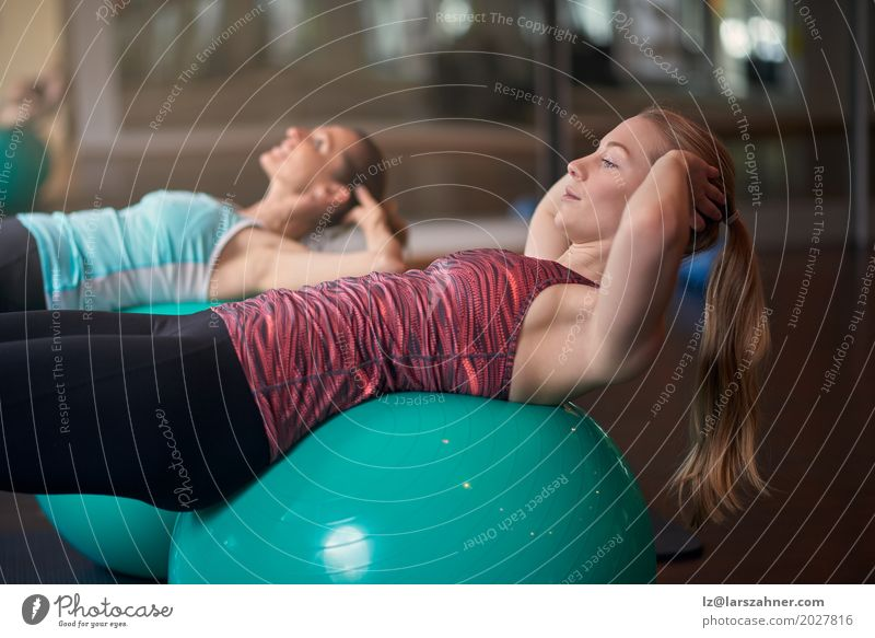 Two women exercising with balls in gym Human being Woman Youth (Young adults) Beautiful 18 - 30 years Face Adults Lifestyle Sports Copy Space Blonde Action