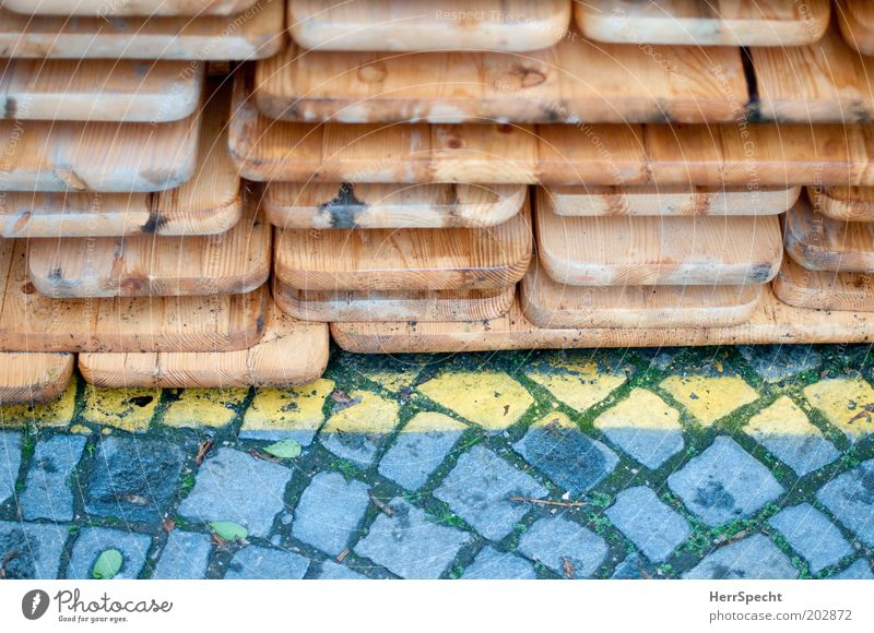 deposit Brown Yellow Gray Paving stone Line Ale bench Beer table Stack Wood Colour photo Subdued colour Exterior shot Close-up Detail Copy Space bottom Day