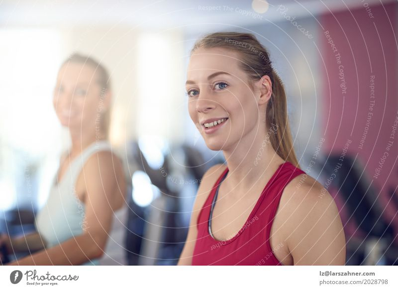 Attractive Woman on treadmill in the gym Lifestyle Happy Beautiful Face Leisure and hobbies Sports Adults 2 Human being 18 - 30 years Youth (Young adults)