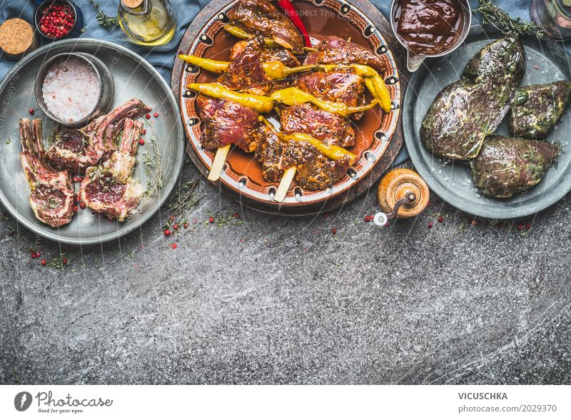 Various marinated meats for grilling or roasting Food Meat Herbs and spices Cooking oil Nutrition Banquet Picnic Organic produce Crockery Bowl Style Design