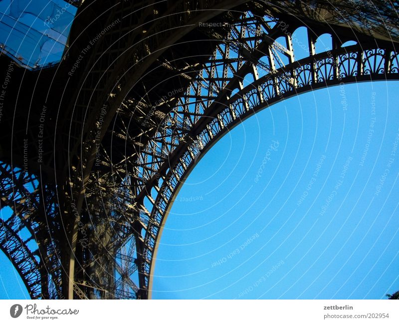 iron tower France Paris Summer Eiffel Tower Arch Steel Iron Construction Structural engineering Riveted Foundations Prop Crossbeam Landmark Vacation & Travel
