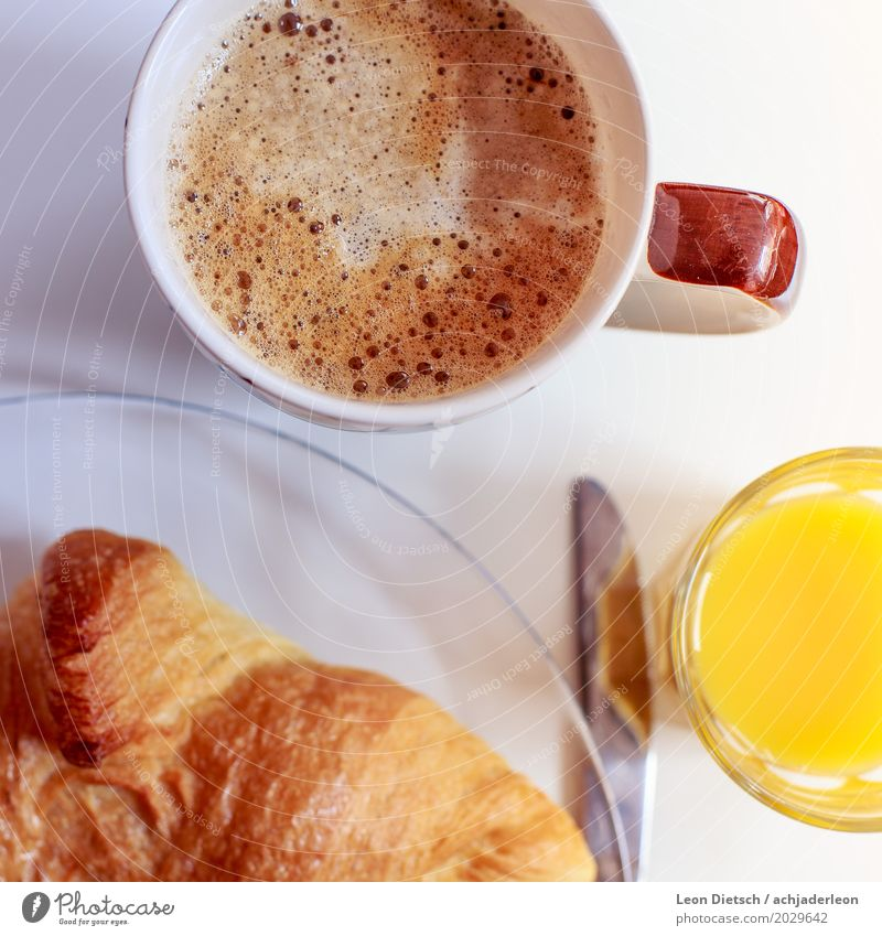Coffee, croissant, juice Food Orange Dough Baked goods Croissant Nutrition Breakfast Beverage Hot drink Juice Plate Cup Glass Knives Fluid Friendliness Healthy