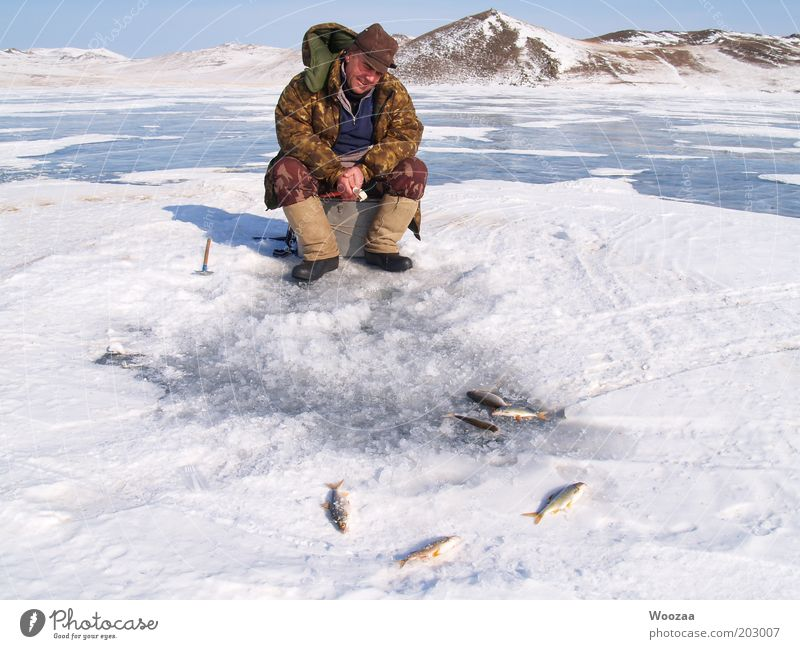 Man Blue White Winter Calm Cold Snow Happy Adults Lake Brown Contentment Ice Sit Wait Adventure