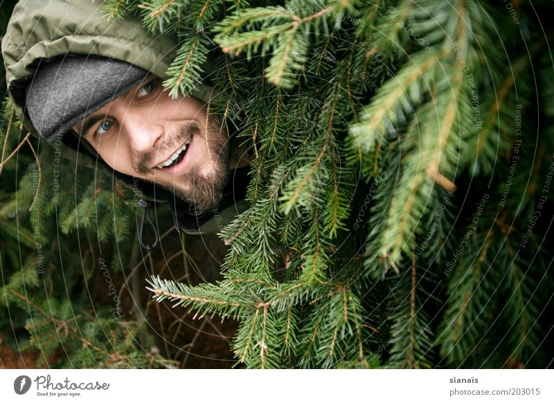 have a luncheon Masculine Man Adults Life Head Fir tree Discover Joy Hide Hiding place Provoke Stupid Daft Green Camouflage Camouflage colour Hooded (clothing)