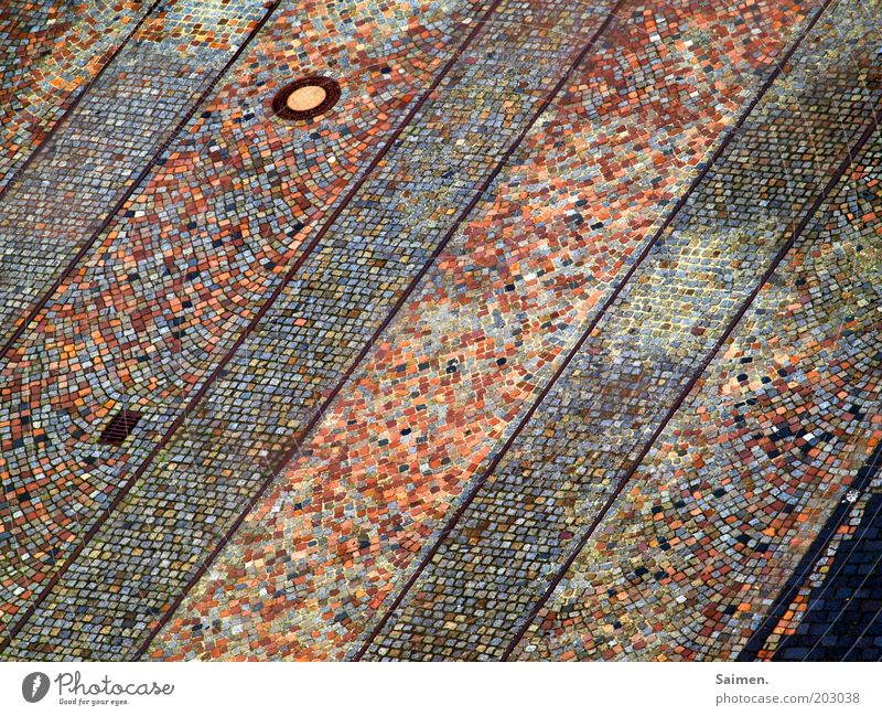 Street Stone Lanes & trails Railroad tracks Traffic infrastructure Cobblestones Gully Mosaic Pavement Rail transport Railroad crossing