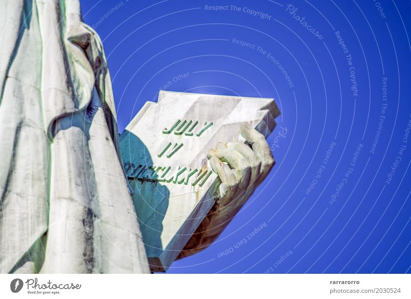 Detail from the Statue of Liberty, New York Tourism Sightseeing Hand Fingers Book Earth Sky Places Landmark Monument Bright Blue Independence 4 Against america