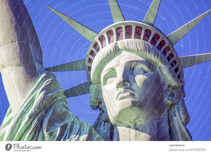 Detail of the Statue of Liberty in New York Face Vacation & Travel Tourism Trip Freedom Book Landscape Sky Clouds River High-rise Architecture Monument Tall