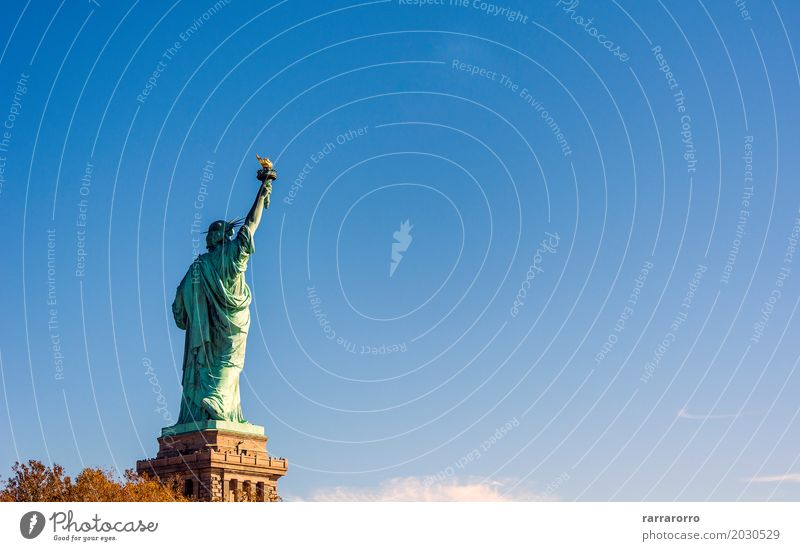 Back of the famous Statue of Liberty Vacation & Travel Tourism Freedom Summer Island Landscape Sky Clouds Skyline Architecture Monument Old Historic New Blue