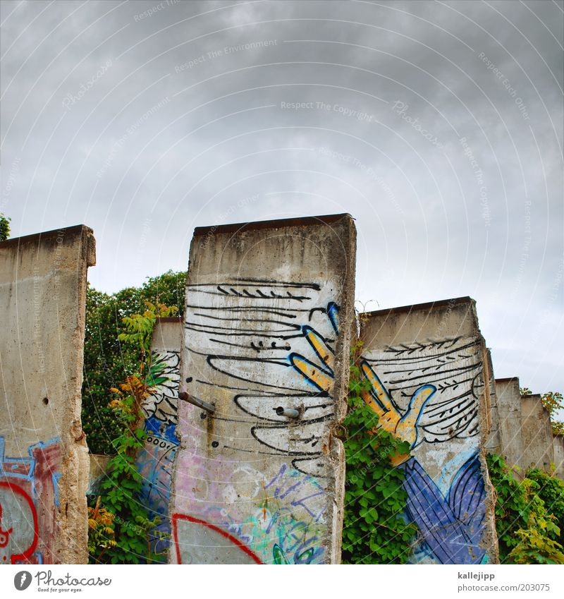 concrete heads Hand Fingers Wing Sign Graffiti Free Freedom The Wall Berlin Sky German Unification Day Colour photo Multicoloured Exterior shot GDR