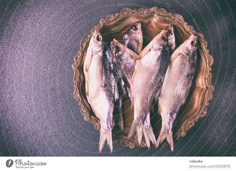 Dried in salt fish rammed in scales Fish Nutrition Plate Rope Eating Retro Black salted dry Carp Ram food background Roach Edible catch fishing vintage