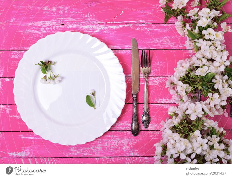 White dish on a pink wooden surface Lunch Dinner Plate Cutlery Knives Fork Table Kitchen Restaurant Flower Paper Wood Metal Steel Old Above Retro Pink Dish Meal