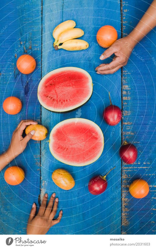 colorful tropical fruits on blue wooden background Blue Summer Colour Hand Red Joy Yellow Natural Wood Fruit Fresh Table Delicious Exotic Dessert Refreshment