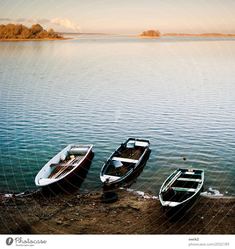 harbor Environment Nature Landscape Water Cloudless sky Horizon Lakeside Island Rowboat Illuminate Lie Calm Relaxation Idyll Far-off places Contentment Peaceful