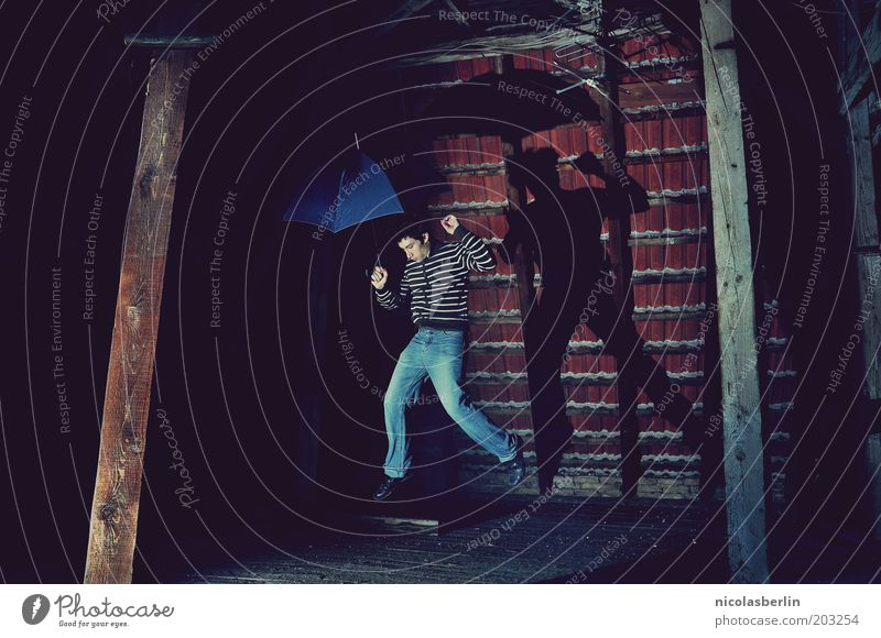 Human being Youth (Young adults) House (Residential Structure) Life Dark Wall (building) Jump Wood Dream Wall (barrier) Air Art Wind Masculine Clothing Umbrella