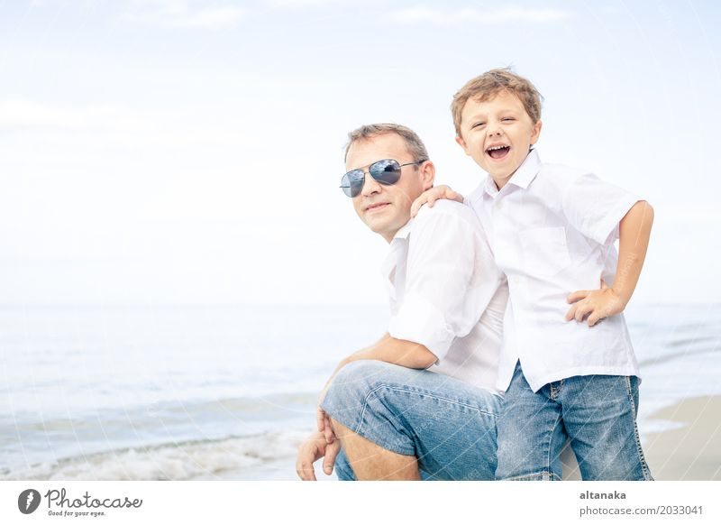 Father and son playing on the beach Child Nature Vacation & Travel Man Summer Sun Ocean Relaxation Joy Beach Adults Life Lifestyle Love Boy (child)