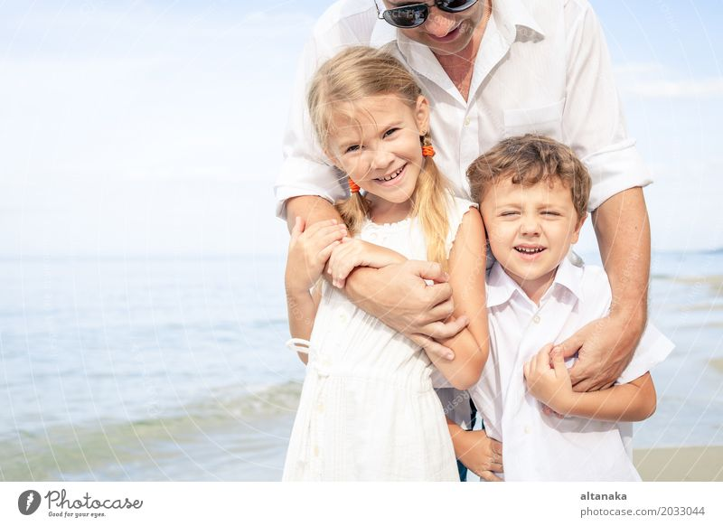 Father and children playing on the beach Child Nature Vacation & Travel Summer Sun Ocean Relaxation Joy Beach Adults Life Lifestyle Love Boy (child)