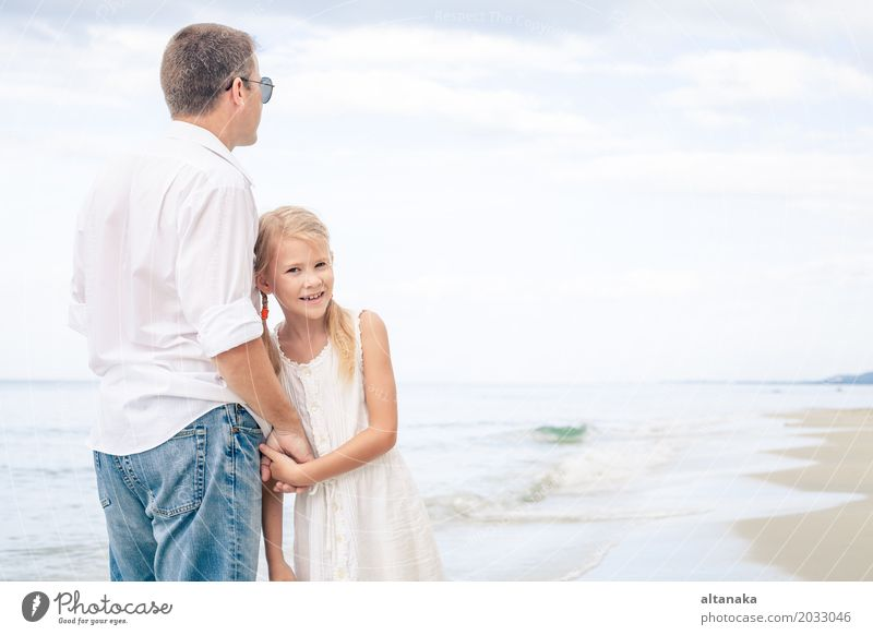 Father and daughter Woman Child Nature Vacation & Travel Summer Sun Hand Ocean Relaxation Joy Beach Adults Life Lifestyle Love Family & Relations
